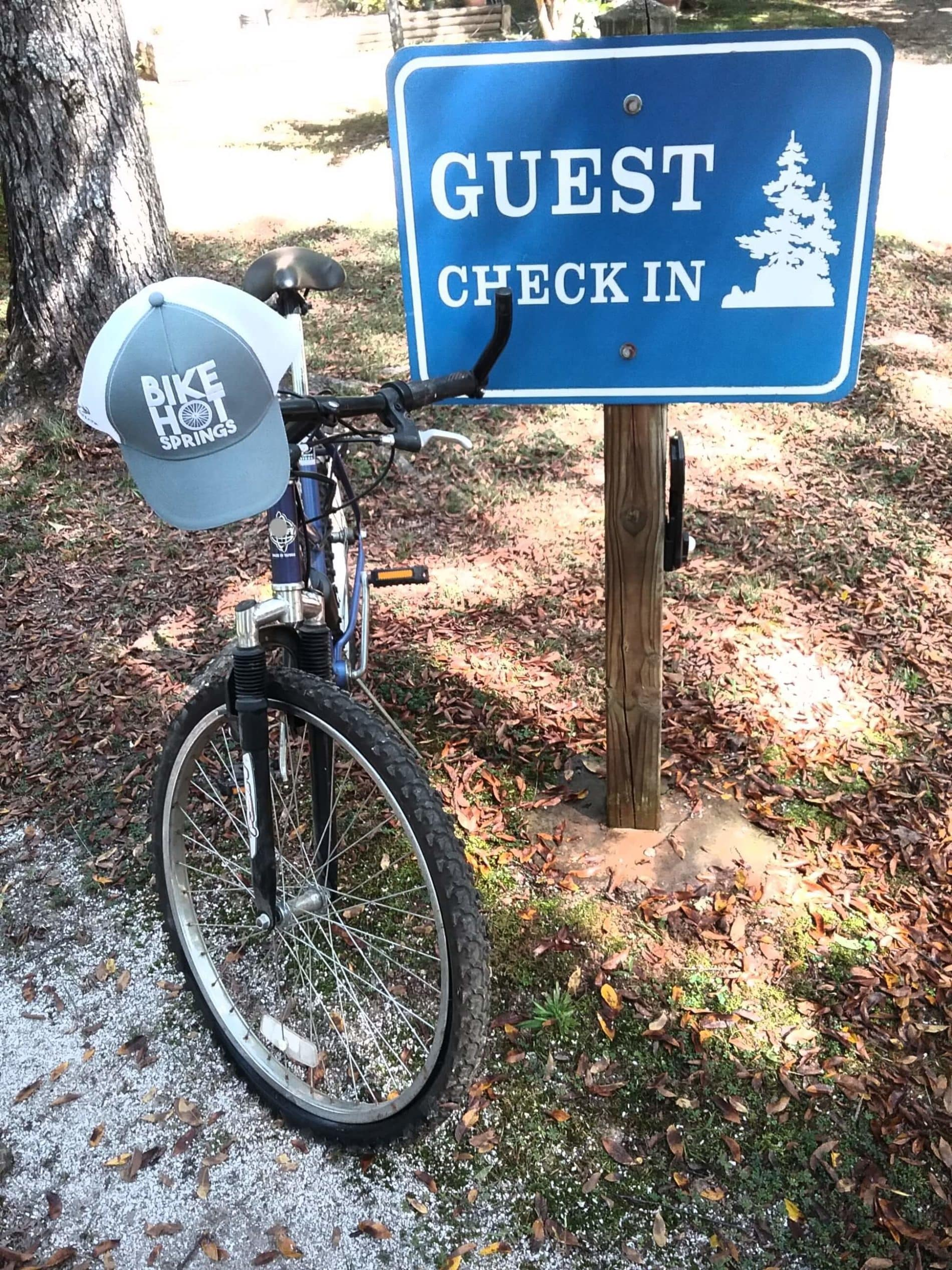 mountain bike leaning against a blue sign