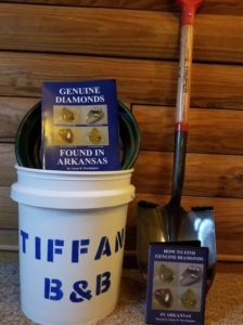 white bucket, shovel, sifting screens, along with book and DVD - all used for diamond mining